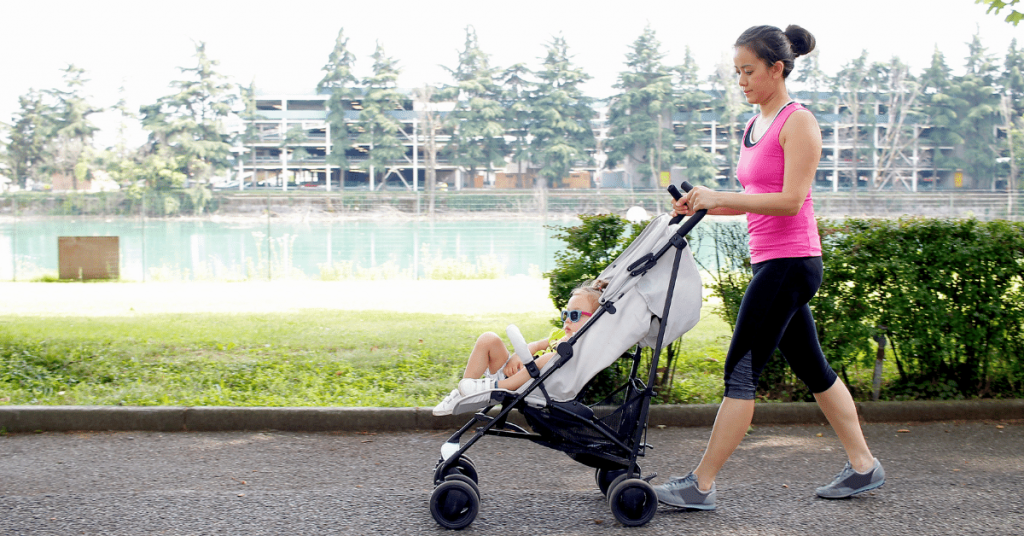 Woman walking with your child in stroller, which is a great way to lose weight for busy moms.
